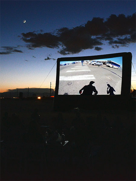 The Prairie Picture Show was an outdoor screening of a film documenting Conor McGarrigle's Walking West performance which took place on the prairie east of Denver.